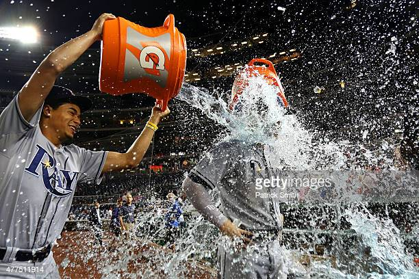 Steven Souza Jr #20 of the Tampa Bay Rays is doused by teammate Chris Archer and David DeJesus after defeating the Washington Nationals at Nationals...
