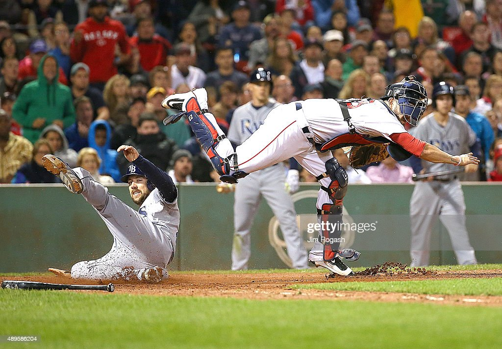 Steven Souza Jr. #20 of the Tampa Bay Rays is out at the plate as Blake Swihart #23 of the Boston Red Sox turns a double play in the seventh inning at Fenway Park on September 22, 2015 in Boston, Massachusetts.
