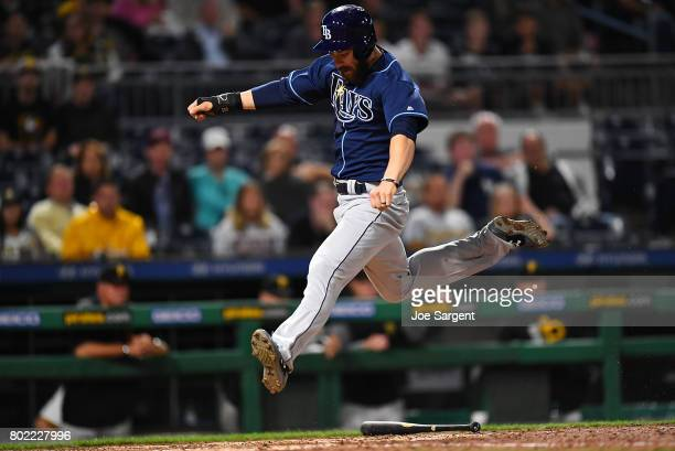 Steven Souza Jr #20 of the Tampa Bay Rays scores during the tenth inning against the Pittsburgh Pirates at PNC Park on June 27 2017 in Pittsburgh...