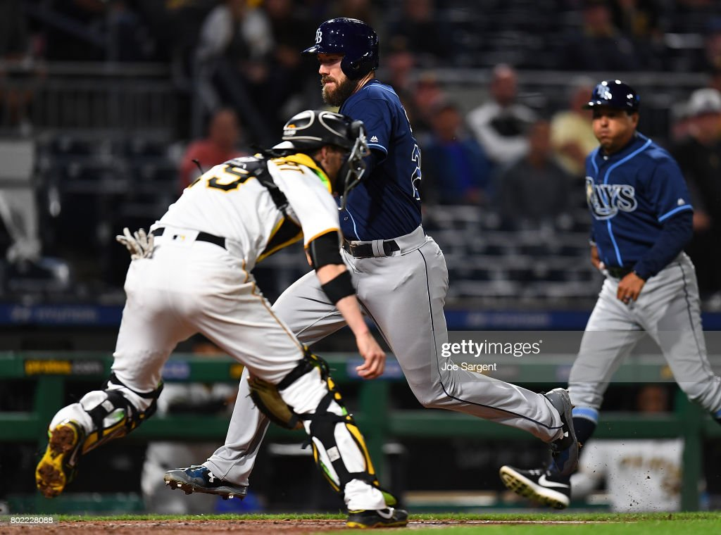 Steven Souza Jr. #20 of the Tampa Bay Rays scores in front of Chris Stewart #19 of the Pittsburgh Pirates during the tenth inning at PNC Park on June 27, 2017 in Pittsburgh, Pennsylvania. Tampa Bay won the game 4-2.