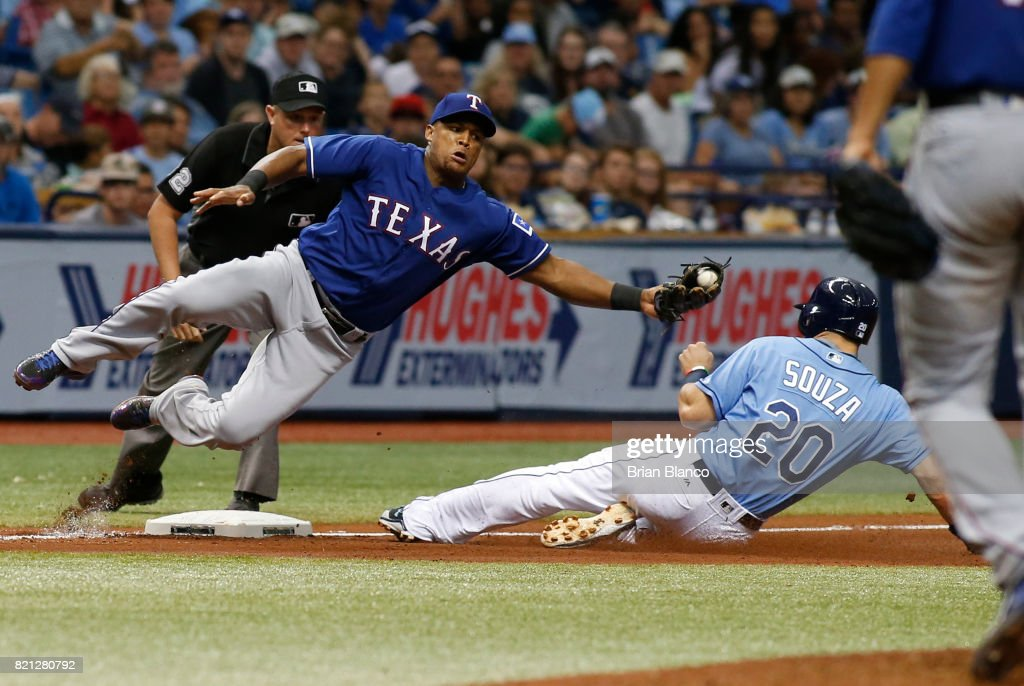 Steven Souza Jr. #20 of the Tampa Bay Rays steals third base ahead of third baseman Adrian Beltre #29 of the Texas Rangers during the fourth inning of a game on July 23, 2017 at Tropicana Field in St. Petersburg, Florida.
