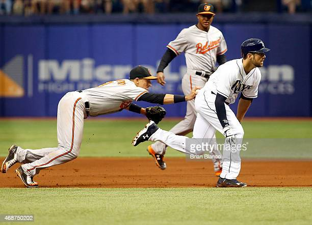 Steven Souza of the Tampa Bay Rays is caught in the rundown between first base and second base by shortstop Ryan Flaherty of the Baltimore Orioles...