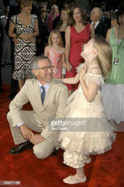 Steven Spielberg and Dakota Fanning during 'War of the Worlds' New York City Premiere Outside Arrivals at Ziegfeld Theatre in New York City New York...