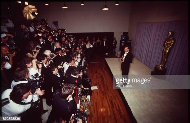 Steven Spielberg facing photographers backstage at the Oscars April 11 1988 Dorothy Chandler Pavilion Los Angeles California