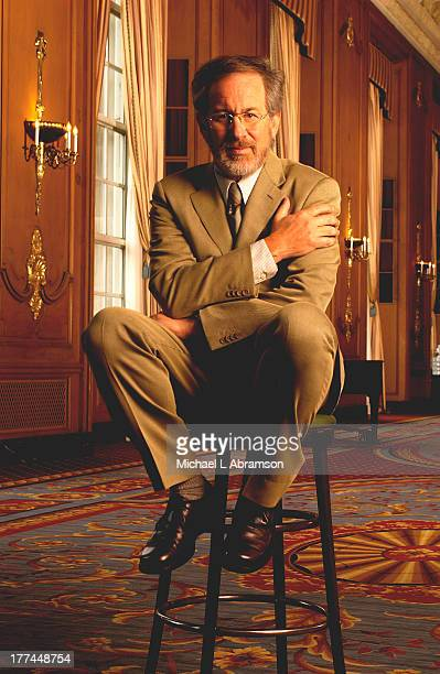 Steven Spielberg famous film director screenwriter producer and studio entrepreneur sitting on a stool with suit and tie April 30 2003