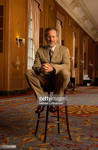 Steven Spielberg, famous film director, screenwriter, producer, and studio entrepreneur, sitting on a stool with suit and tie, April 30, 2003.