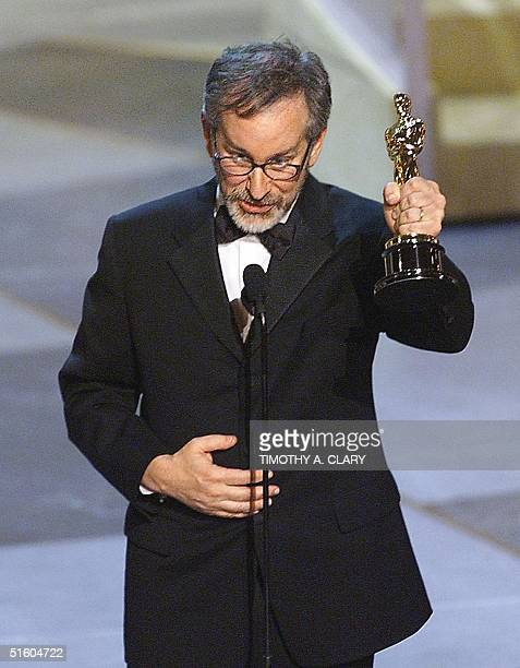 Steven Spielberg holds his Oscar after winning for Best Director for his movie Saving Private Ryan during the 71st Academy Awards 21 March 1999 at...