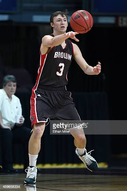 Steven Spieth of the Brown Bears passes against the Austin Peay Governors during the 2014 Continental Tire Las Vegas Invitational basketball...