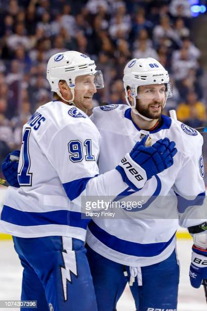Steven Stamkos and Nikita Kucherov of the Tampa Bay Lightning celebrate a third period goal against the Winnipeg Jets at the Bell MTS Place on...