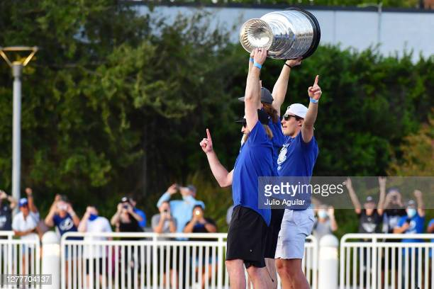 Steven Stamkos and Victor Hedman hoist up the Stanley Cup next to Luke Schenn of the Tampa Bay Lightning during the Victory Rally & Boat Parade on...
