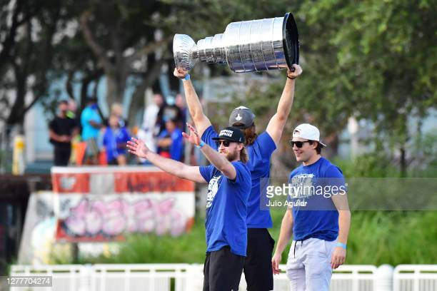 Steven Stamkos celebrates as Victor Hedman hoists the Stanley Cup up next to Luke Schenn of the Tampa Bay Lightning during the Victory Rally & Boat...
