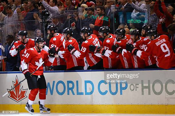 Steven Stamkos of Team Canada is congratulated by his teammates after scoring a first period goal against Team Europe during Game One of the World...
