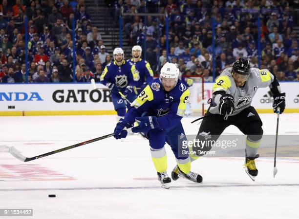 Steven Stamkos of the Tampa Bay Lightning and Alexander Ovechkin of the Washington Capitals fight for the puck during the 2018 Honda NHL AllStar Game...