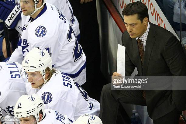 Steven Stamkos of the Tampa Bay Lightning and head coach Guy Boucher look on during their NHL game against the Winnipeg Jets at MTS Centre on...