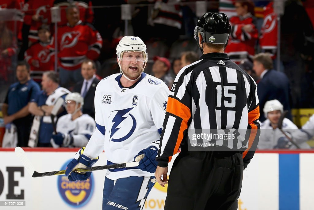Steven Stamkos #91 of the Tampa Bay Lightning argues a penalty call by referee Jean Hebert #15 in Game Three of the Eastern Conference First Round against the New Jersey Devils during the 2018 NHL Stanley Cup Playoffs at Prudential Center on April 16, 2018 in Newark, New Jersey.