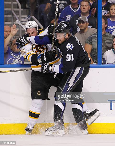 Steven Stamkos of the Tampa Bay Lightning battles for position against Brad Marchand of the Boston Bruins during the first period in Game Four of the...