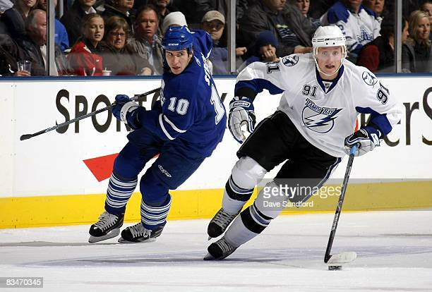 Steven Stamkos of the Tampa Bay Lightning caries the puck as he is defended by Alex Steen of the Toronto Maple Leafs during their NHL game at the Air...
