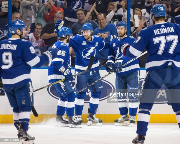 Steven Stamkos of the Tampa Bay Lightning celebrates a goal with teammates Nikita Kucherov and Dan Girardi against the Detroit Red Wings during the...