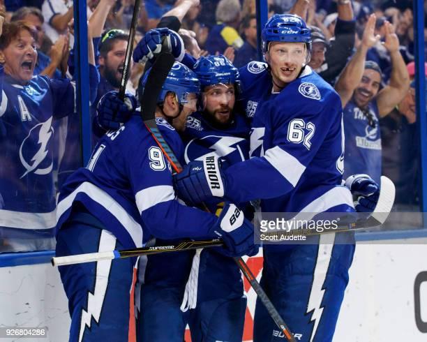 Steven Stamkos of the Tampa Bay Lightning celebrates a goal with teammates Nikita Kucherov and Andrej Sustr against the Philadelphia Flyers during...