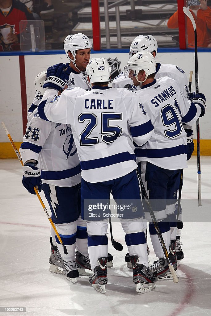 Steven Stamkos #91 of the Tampa Bay Lightning celebrates his game winning goal with teammates against the Florida Panthers at the BB&T Center on March 12, 2013 in Sunrise, Florida.