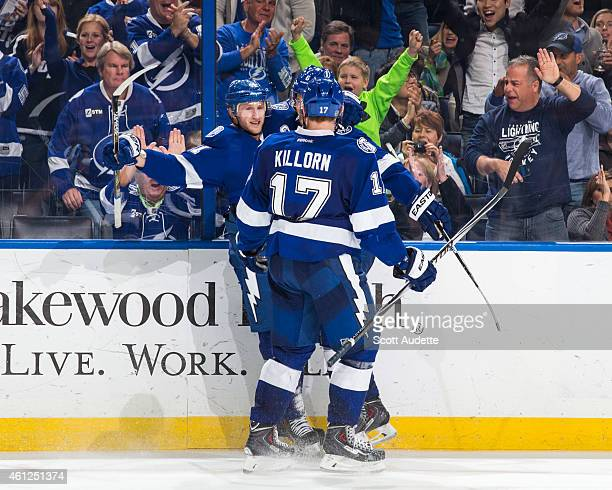 Steven Stamkos of the Tampa Bay Lightning celebrates his goal with teammates during the third period against the Buffalo Sabres at the Amalie Arena...