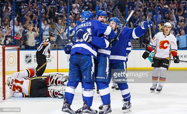 Steven Stamkos of the Tampa Bay Lightning celebrates his goal with teammates Alex Killorn and Tyler Johnson against goalie Karri Ramo and Mikael...
