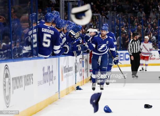Steven Stamkos of the Tampa Bay Lightning celebrates his third goal of the game to complete the hat trick against the New York Rangers during the...