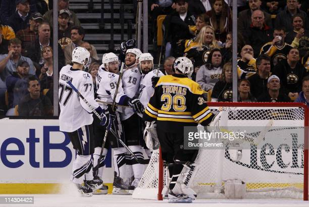 Steven Stamkos of the Tampa Bay Lightning celebrates his third period goal with teammates as Tim Thomas of the Boston Bruins looks on in Game Two of...
