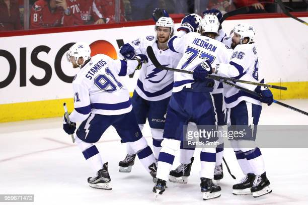 Steven Stamkos of the Tampa Bay Lightning celebrates with his teammates after scoring a goal against Braden Holtby of the Washington Capitals during...