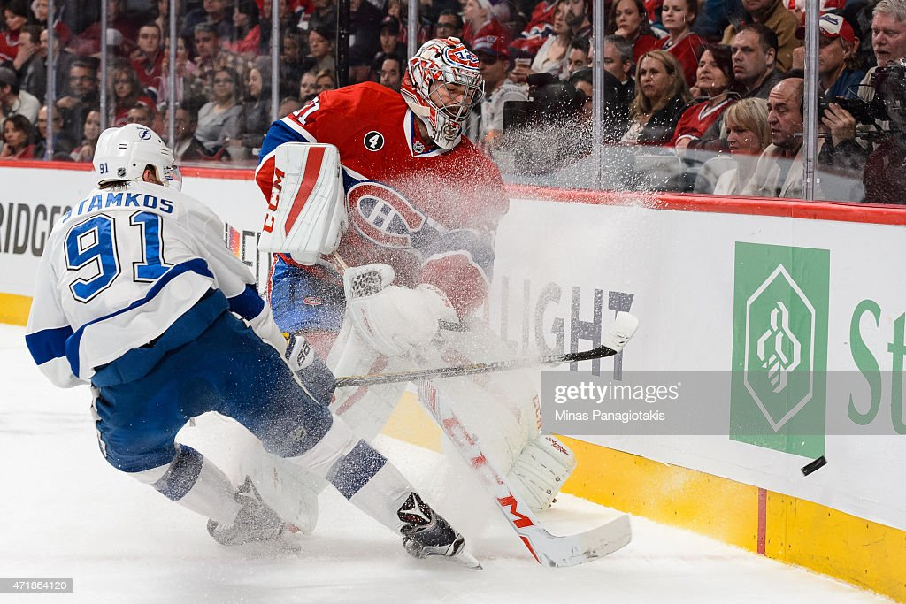 Steven Stamkos #91 of the Tampa Bay Lightning challenges Carey Price #31 of the Montreal Canadiens as he clears the puck against the boards in Game One of the Eastern Conference Semifinals during the 2015 NHL Stanley Cup Playoffs at the Bell Centre on May 1, 2015 in Montreal, Quebec, Canada.