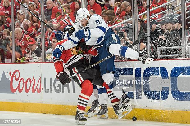 Steven Stamkos of the Tampa Bay Lightning checks Johnny Oduya of the Chicago Blackhawks during Game Six of the 2015 NHL Stanley Cup Final at the...