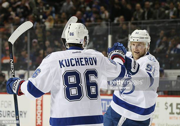 Steven Stamkos of the Tampa Bay Lightning congratulates Nikita Kucherov on his powerplay goal at 321 of the first period against the New York...