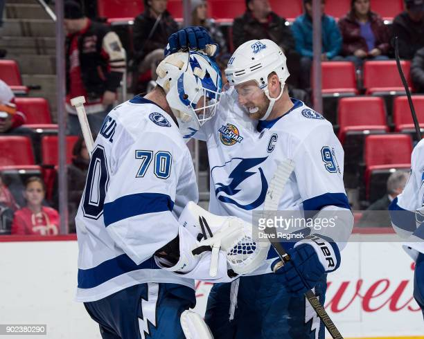Steven Stamkos of the Tampa Bay Lightning congratulates teammate goaltender Louis Domingue of the Tampa Bay Lightning following an NHL game against...