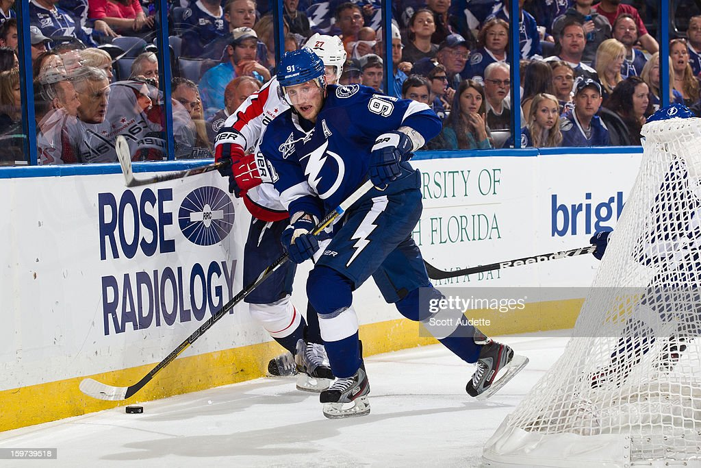 Steven Stamkos #91 of the Tampa Bay Lightning controls the puck against Karl Alzner #27 of the Washington Capitals during the third period at the Tampa Bay Times Forum on January 19, 2013 in Tampa, Florida.