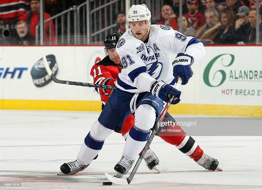 Steven Stamkos #91 of the Tampa Bay Lightning controls the puck against the New Jersey Devils at the Prudential Center on February 7, 2013 in Newark, New Jersey.