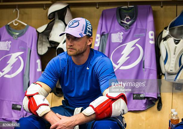 Steven Stamkos of the Tampa Bay Lightning gets ready for the pregame warm ups as he and teammates wear lavender jerseys for Hockey Fights Cancer...