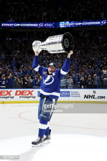 Steven Stamkos of the Tampa Bay Lightning hoists the Stanley Cup after their 1-0 win in Game Five of the 2021 Stanley Cup Final to win the series...