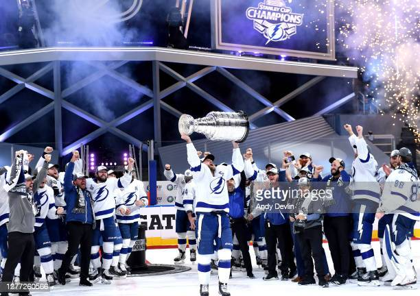 Steven Stamkos of the Tampa Bay Lightning hoists the Stanley Cup overhead after the Tampa Bay Lightning defeated the Dallas Stars 2-0 in Game Six of...
