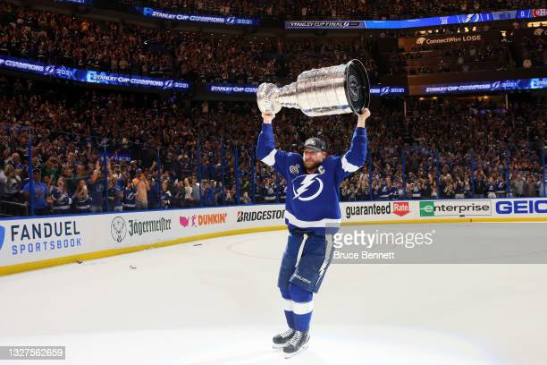 Steven Stamkos of the Tampa Bay Lightning hoists the Stanley Cup after the 1-0 victory against the Montreal Canadiens in Game Five to win the 2021...
