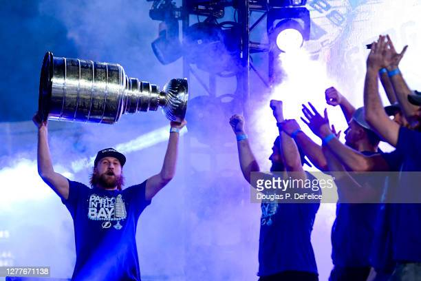 Steven Stamkos of the Tampa Bay Lightning holds the Stanley Cup trophy above his head during the 2020 Stanley Cup Champion rally on September 30,...
