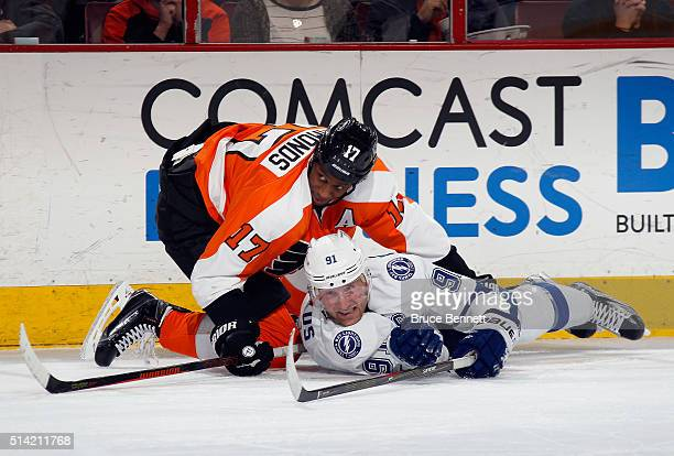 Steven Stamkos of the Tampa Bay Lightning is checked by Wayne Simmonds of the Philadelphia Flyers during the second period at the Wells Fargo Center...