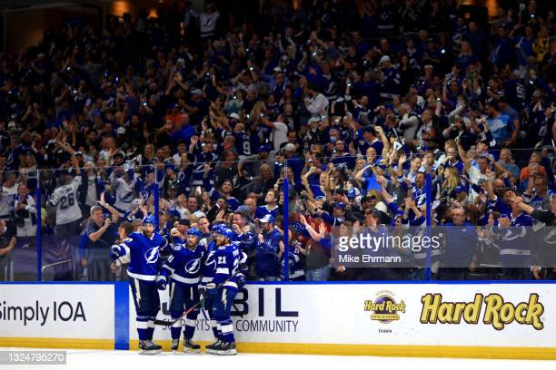 Steven Stamkos of the Tampa Bay Lightning is congratulated by his teammates after scoring a goal against the New York Islanders during the second...