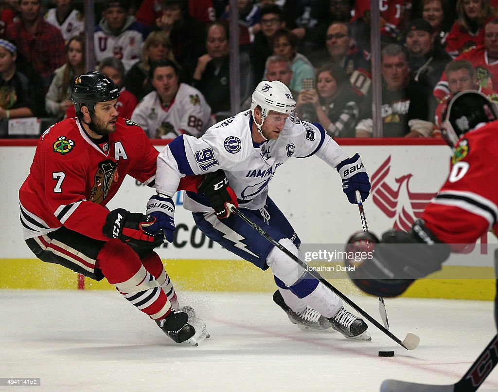 Steven Stamkos #91 of the Tampa Bay Lightning is pressured by Brent Seabrook #7 of the Chicago Blackhawks as he skates toward Corey Crawford #50 at the United Center on October 24, 2015 in Chicago, Illinois.