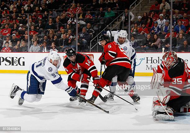 Steven Stamkos of the Tampa Bay Lightning is stopped during the first period by Cory Schneider of the New Jersey Devils at the Prudential Center on...