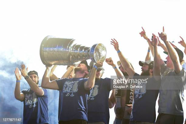 Steven Stamkos of the Tampa Bay Lightning kisses the Stanley Cup trophy above his head during the 2020 Stanley Cup Champion rally on September 30,...