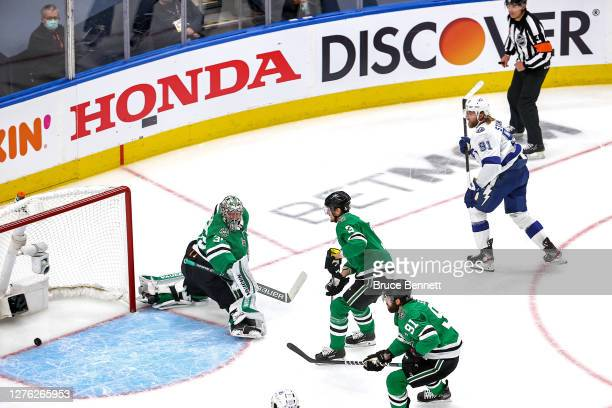 Steven Stamkos of the Tampa Bay Lightning scores a goal against Anton Khudobin of the Dallas Stars during the first period in Game Three of the 2020...
