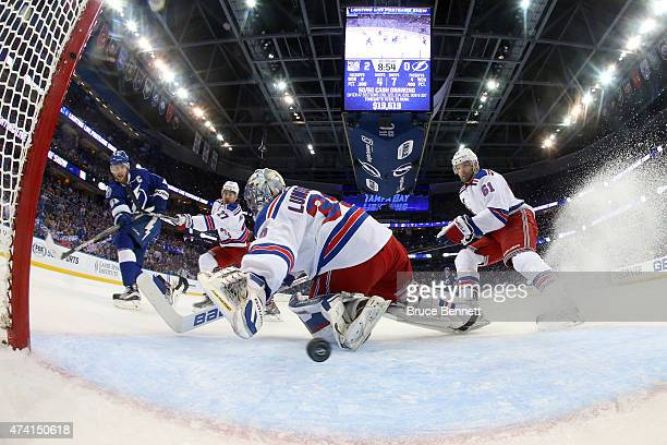 Steven Stamkos of the Tampa Bay Lightning scores a goal in the first period against Henrik Lundqvist of the New York Rangers during Game Three of the...