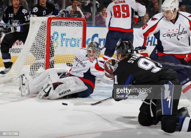 Steven Stamkos of the Tampa Bay Lightning scores a goal on his knees against goaltender Michal Neuvirth of the Washington Capitals at the St Pete...