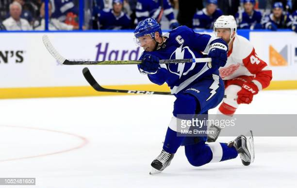 Steven Stamkos of the Tampa Bay Lightning scores his first goal of the season during a game against the Detroit Red Wings at Amalie Arena on October...