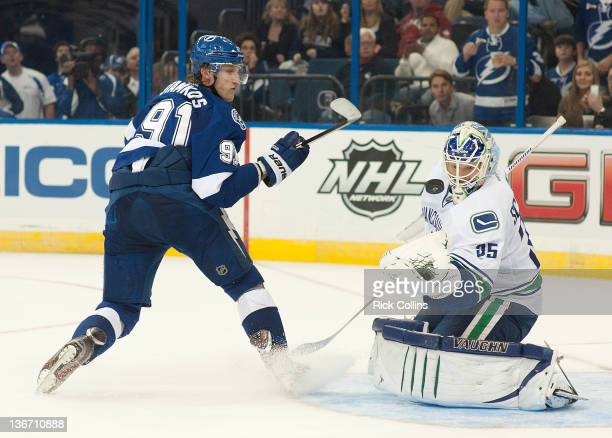 Steven Stamkos of the Tampa Bay Lightning shoot the puck on Cory Schneider of the Vancouver Canucks at the Tampa Bay Times Forum on January 10 2012...